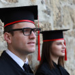 Young Couple in the Graduation Day — Stock Photo
