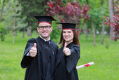 Happy Couple in the Graduation Day — Stock Photo