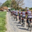 Amateur Cyclists on a Cobblestone Road — Stock Photo