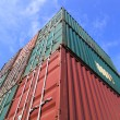 Stack of Cargo Containers at the docks — Stock Photo #12740064