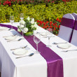 Outdoor tables with served plate and wine glasses - Stock Photo
