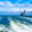 Cargo ship sailing in to the sea — Stock Photo