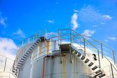 Oil storage tanks under blue sky — Stock Photo