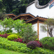 Chinese garden with hillside traditional building. — Stock Photo