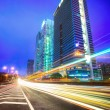 Night traffic trails on the cityscape background — Stock Photo