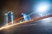 Night traffic on cityscape background — Stock Photo