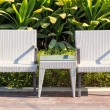 Outdoor furniture rattan armchairs and table on terrace — Stock Photo
