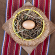 Egg in basket traditional still-life - Stock Photo