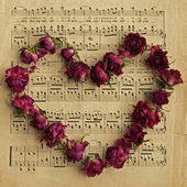 Notes and flower heart — Stock Photo