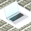 Laptop on paper dollars - Stock Photo