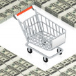 Shopping cart on paper dollars - Stock Photo