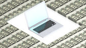 Laptop on paper dollars — Stock Photo