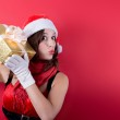 Picture of lovely woman in red dress with present — Stock Photo #33971183