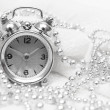 Hours and beads on a white background — Stock Photo #2769885