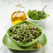 Integral pasta with arugula pesto — Stock Photo