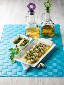 Cod fillet marinated with parsley anchovy and garlic — Stock Photo
