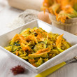 Pasta with zucchinis flower and saffron, selective focus — Stock Photo