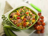 Cold rice salad with tuna and pineapple, selective focus — Stock Photo