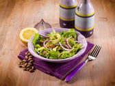 Salad with avocado lettuce beans and onions — Stock Photo