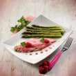 Sole fish with raspberry cream and asparagus — Photo