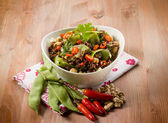 Red rice with flat green beans chickpeas leek and hot chili pepp — Stock Photo