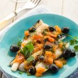 Cod fillet with black olives and fresh tomatoes — Stock Photo