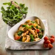 Pasta with chicken chest spinach and tomatoes — Stock Photo