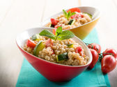 Barley risotto with zucchinis and fresh tomatoes — Stock Photo