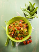 Salad with flat green beans and tomatoes — Stock Photo