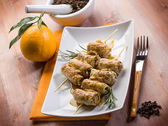 Skewer rolled up with clove and orange juice — Stock Photo