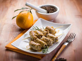 Skewer rolled up with clove and orange juice, selective focus — Stock Photo
