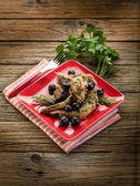 Roasted rabbit with herbs and black olives — Stock Photo