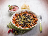 Pasta with olives tomato and cheese — Photo
