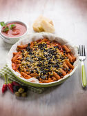 Pasta with olives tomato and cheese, selective focus — Photo