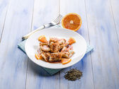 Salted cod with orange juice and fennel seeds — Stock Photo