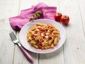 Fusilli with mozzarella tomatoes and hot chili pepper — Stock Photo