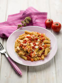 Fusilli with mozzarella tomatoes and hot chili pepper, selective — Stock Photo