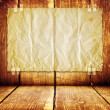 Wooden room with paper on wall — Stock Photo
