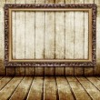 Golden frame in wooden room — Stock Photo