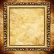 Golden frame on brown grunge background — Stock Photo