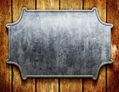 Vintage metal signboard on old wooden planks — Stockfoto