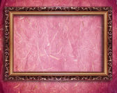 Golden frame on red wall — Stock Photo