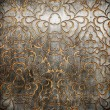 Metal ornament on old wooden background — Stock Photo