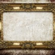 Golden frame on grunge background — Stockfoto