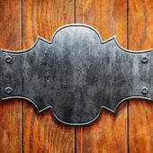 Vintage metal signboard on old wooden planks — Stok fotoğraf
