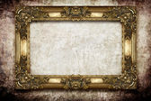 Golden frame on grunge background — Stock Photo