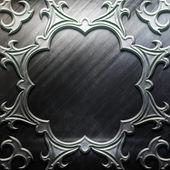 Metallplatte mit geschnitzten muster — Stockfoto
