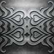 Stockfoto: Metal Plate with carved pattern