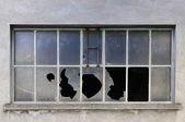 Old industrial windows with broken glasses — Stok fotoğraf