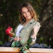 Stock Photo: Young woman with a roses